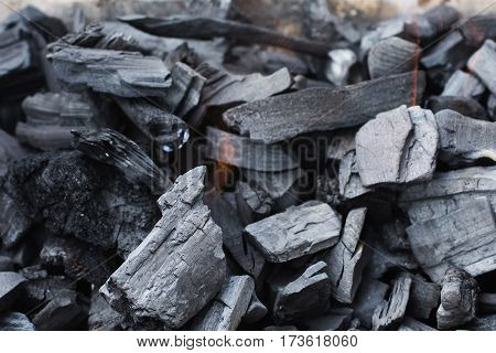 Black coal burning. Natural fuel. Cooking outdoors on coal
