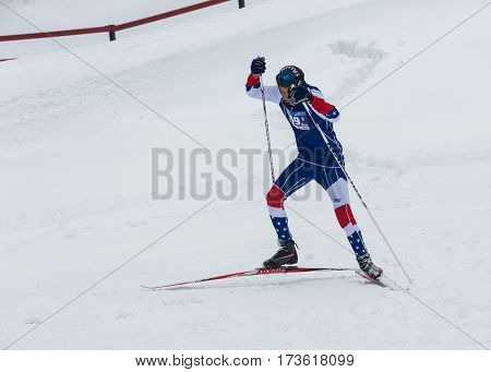 ALMATY, KAZAKHSTAN - FEBRUARY 18, 2017: amateur competitions in the discipline of cross-country skiing, under the name of ARBA Ski Fest. A man cross-country skiing on the trail in Almaty mount.