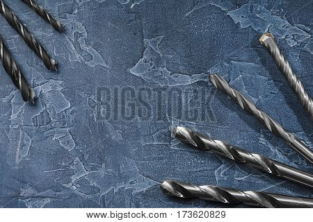 Workplace On A Dark Stone With Drill Bit