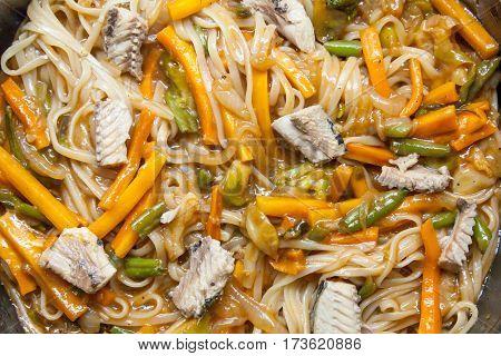 Asian noodles udon and vegetables stir fry