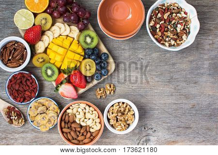 Healthy and various morning breakfast selection paleo style: oat free gluten free cereals nuts fruits berries selective focus. Top view