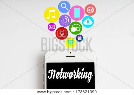"""Networking"" words on smartphone with social media icon with white background - business finance and copy space concept"
