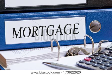 Mortgage - blue binder on desk in the office