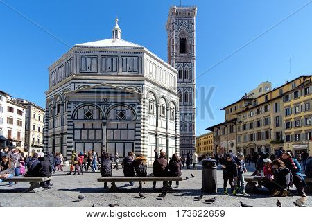 Florence Italy - February 25 2016: Baptistery (Battistero di San Giovanni Baptistery of Saint John) on Piazza del Duomo with the cathedral bell tower