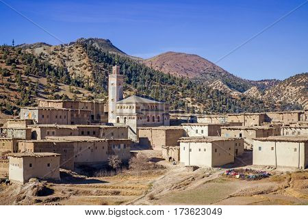 Small village with mosque in the High Atlas Mountains  in Morocco. panorama view with Vintage editing