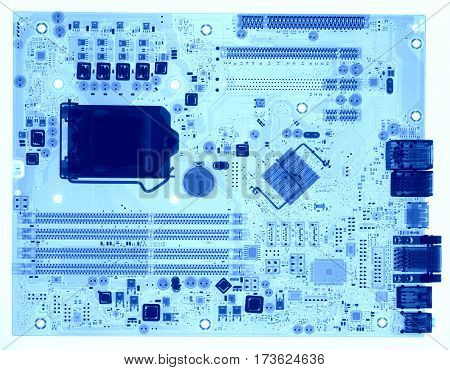 Motherboard under X-rays in blue tones on white background. Visibility through. Image was obtained with real X-ray machine.