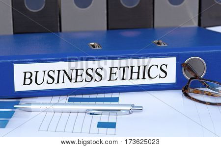Business Ethics - blue binder on desk in the office