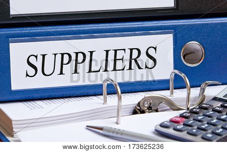Suppliers - blue binder on desk in the office