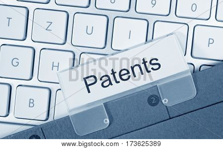 Patents - folder with text on computer keyboard
