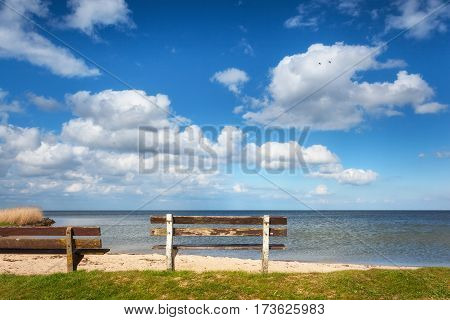 Bench On The Sandy Beach At The Sea