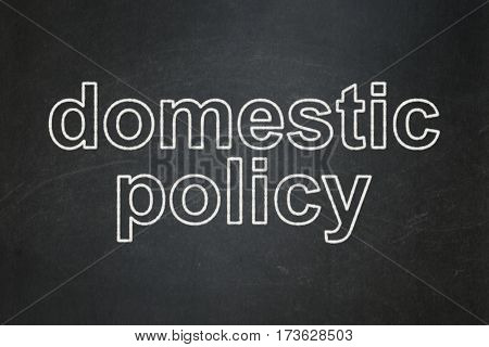 Politics concept: text Domestic Policy on Black chalkboard background