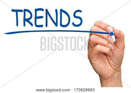 Trends - female hand writing text on white background