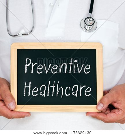 Preventive Healthcare - Doctor holding chalkboard with text