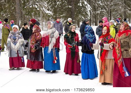 PETROZAVODSK, RUSSIA - FEBRUARY 26TH, 2017: Maslenitsa - folk group participating at the spring coming festival, which is traditionally celebrated in Eastern Europe