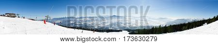 Panorama Of Chair Lift On The Top Of Ski Slope Of Skiing Park Kubinska Hola In Winter.