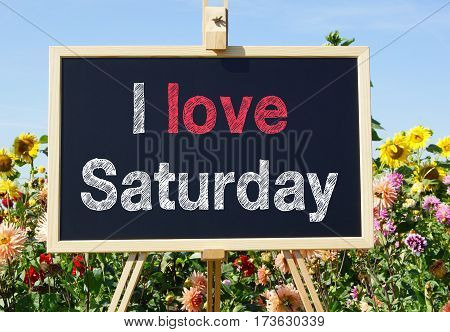 I love Saturday - easel with text in the summer garden