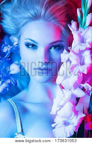 Beauty Fashion Model Girl With Flowers. Colorful Photo