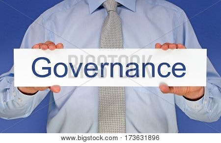 Governance - Businessman holding sign with text