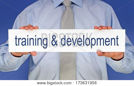 training and development - Businessman holding sign with text