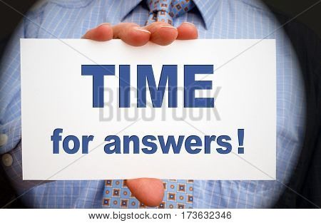 Time for answers - Businessman with sign and text