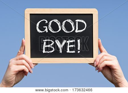 Good Bye - female hands holding chalkboard with text