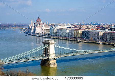 Skyline Panorama Of Budapest, Chain Bridge, Hungarian Parliament And Houses.