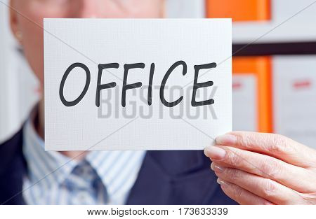 Office - Businesswoman holding sign with text