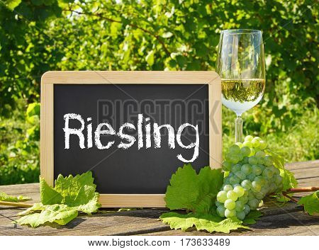 Riesling - chalkboard with text and glass of white wine