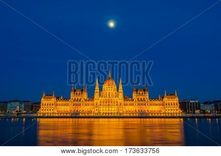 Night View Of The Illuminated Building Of The Hungarian Parliament In Budapest.