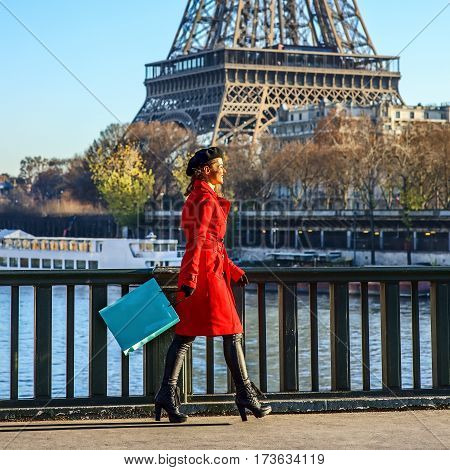 Woman On Embankment Near Eiffel Tower In Paris, France Walking