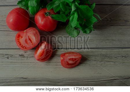 Appetizing fresh vegetables. Ripe tomatoes and fresh herbs. Healthy eating and diet. Natural and good for health.
