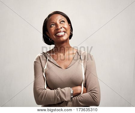 Thinking smiling african woman
