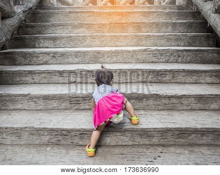 little girl try to go to the top by herself