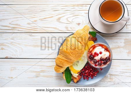 Fresh Croissant Sandwich, Homemade Yogurt, Pomegranate And Tea