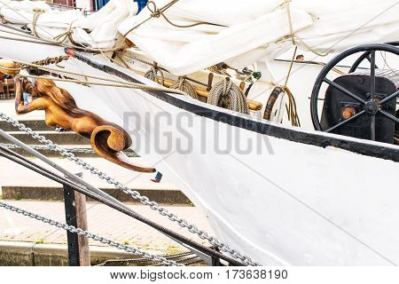 Details of bowsprit Steering wheel and Belayingl pins of the tall ship