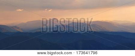 Summer Sunset In Mountains