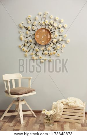 Clock decorated with flowers on wall