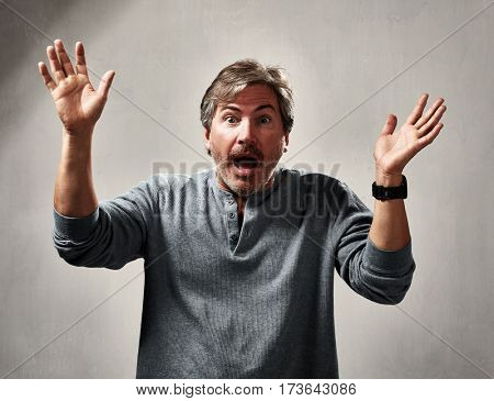 glad excited laughing mature man expressions over gray background