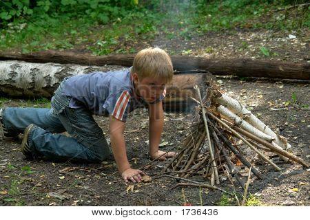 Boy Kindles Bonfire