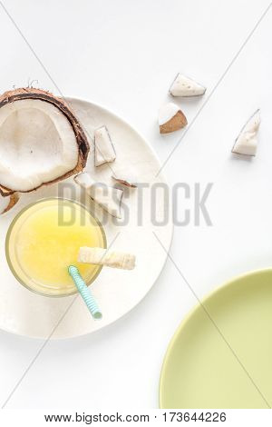 cocktail with coconut on white background top view.