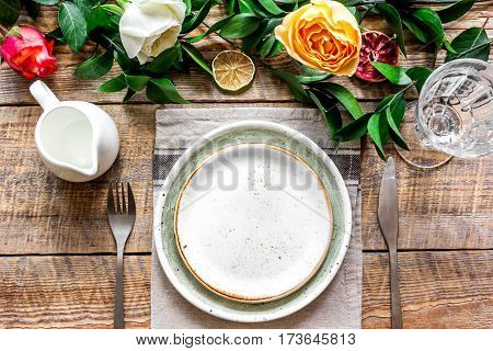 ceramic tableware top view on wooden background mock up.