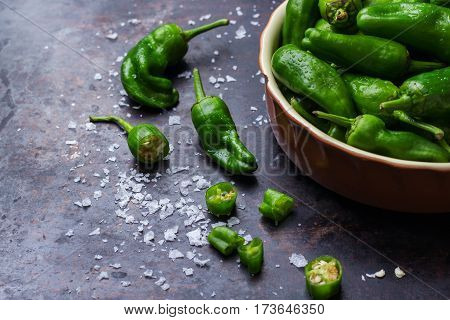 Food and drink, still life concept. Raw green peppers pimientos de padron mexican jalapeno traditional spanish tapas on a table. Copy space background