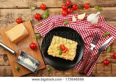 Homemade meat lasagna on wooden table, top view