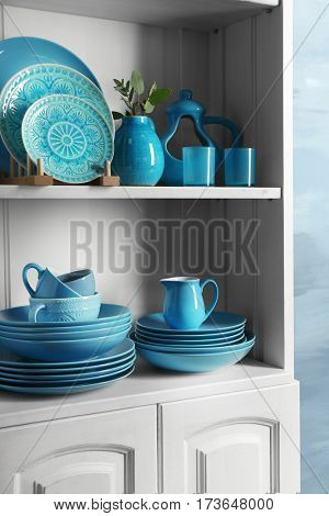 Wooden shelves with blue rustic dinnerware