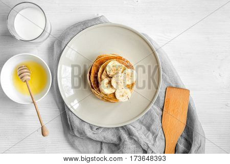 cooked pancake on plate top view at wooden background.