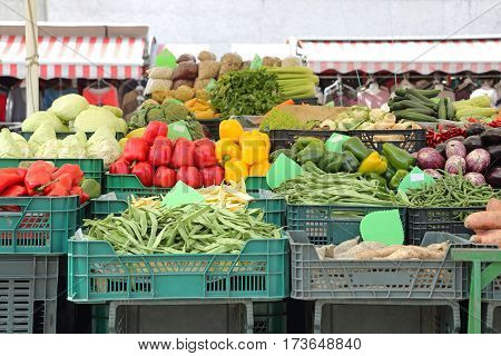Vegetables in Crates at Farmers Market Stall