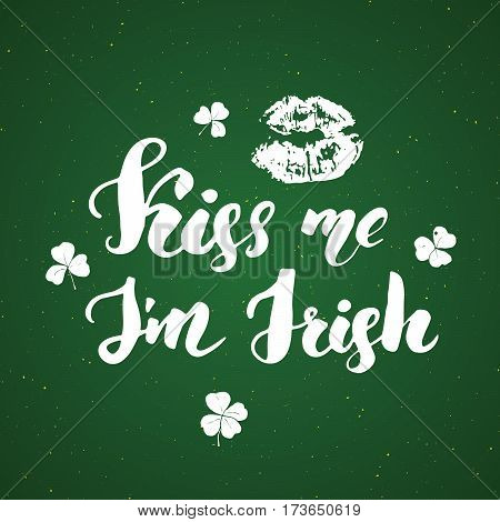 Kiss me I'm irish. St Patrick's Day greeting card Hand lettering with lips and clovers Irish holiday brushed calligraphic sign vector illustration