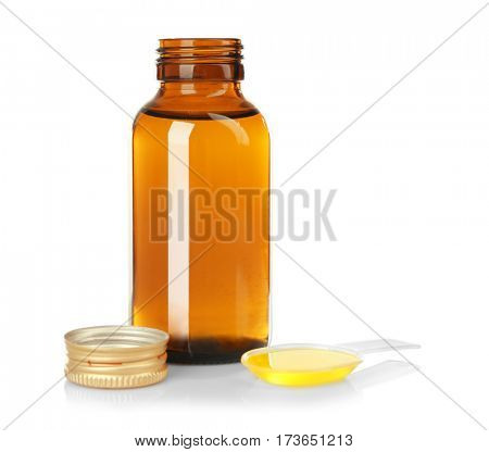 Bottle with cough medicine syrup and poured dose in spoon isolated on white