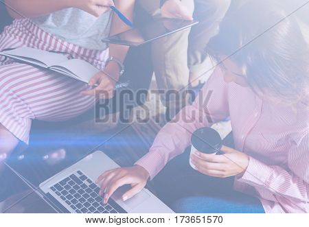 Account managers on work process.Young business woman working at office, using laptop and digital tablet. Horizontal, visual effects