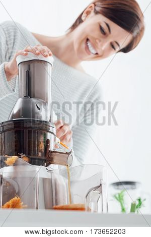 Woman Using A Juice Extractor